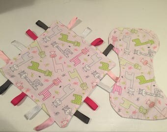 Tag blanket and burp cloth