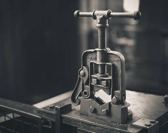 Black and white photograph of a vice
