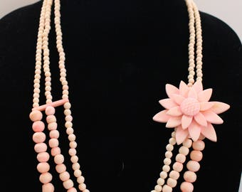 NMN # 1 Natural Materials or Possibly Resin Three Strand Pink Bead Necklace with Large Petaled Flower Adornment