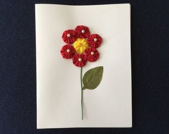 Greeting Card with a Red Flower Design