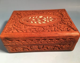 Vintage Handcarved wood jewelry box with bone inlay.
