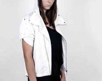 A jacket, a white jacket, an autumn jacket, a spring jacket, a jacket with glasses, a unique jacket, an unusual jacket, a best jacket.