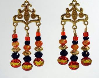 Halloween or Fall season chandelier earrings in orange, black and gold