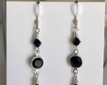 Pretty black Swarovski crystals adorn these earrings. Bezel set for accent effect