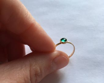 14kt gold ring with created emerald cabochon