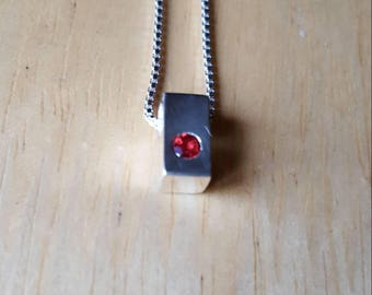 3mm red sapphire  in a silver block necklace
