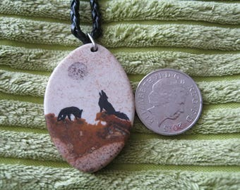 wolf howling at a full moon pendant