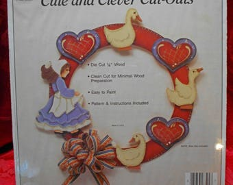 Cute and Clever Cut-Outs Wreath With Geese, Girl, Hearts