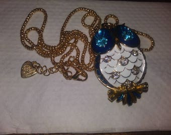 Big Cinnamon Bun Bath bomb with beautiful girls blue owl fashion jewelry necklace hidden inside.
