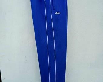 vintage 90s asics track pants blue colour and white strike sportwear streetwear activewear hip hop music band