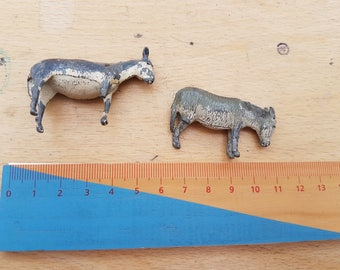 Two vintage lead cold painted donkeys, possibly by Britain's