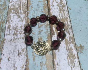 Purple and silver beaded stretch bracelet