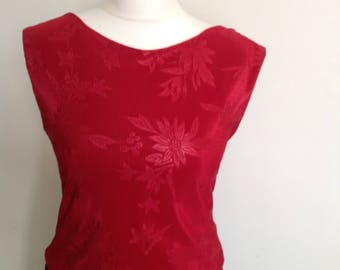 Short style red top with v back in small size