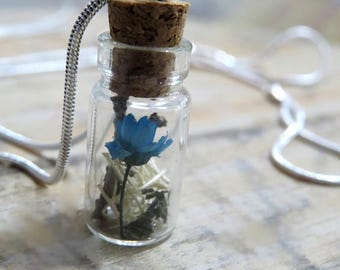 Pendant made with flowers.