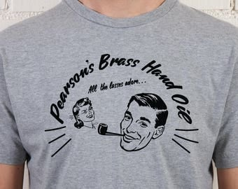 Athletico Mince Vintage Style Brass Hand Oil logo T-Shirt for men, inspired by Bob Mortimer