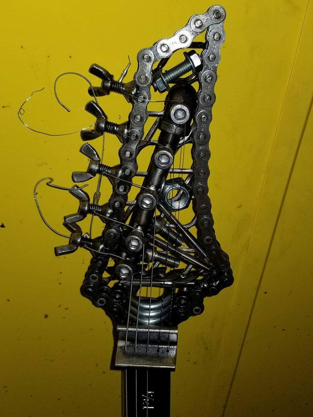 Welded Scrap Metal Guitar Head.
