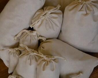 Cotton Double Drawstring Muslin Bag. Sizes: 2x3, 3x5, 4x6, 5x7, 6x8, 6x10, 8x10, 8x12, 10x12, 12x16. Pack of 12