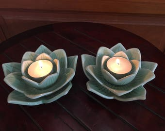 Two Celadon Lotus Candle Holder With Freehand Carving.
