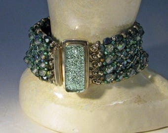 A Right Angle Weave Bracelet of Blue Czech Crystals, Seed beads and a Sterling Silver clasp