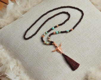 Beautiful, handmade necklace in dark brown with elements in turquoise and Rosé gold