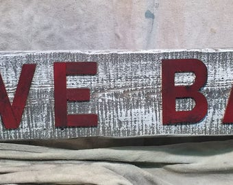 "Weathered ""Live Bait"" sign."