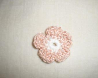 Set of six crochet flowers pressed