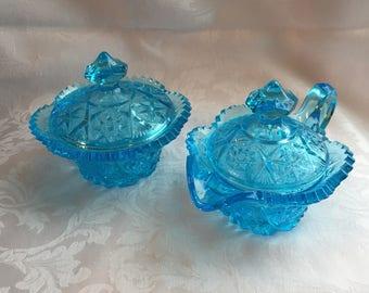 Vintage blue glass creamer and sugar bowl