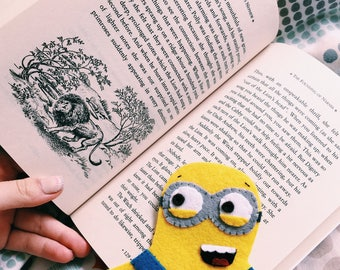 Book. Felt yellow minion bookmark for reading. School reading for pupils with bright bookmark. Back to school.