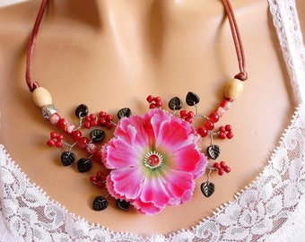 Copper flower wire branch necklace pink fabric.