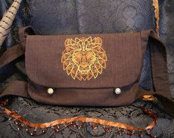 Embroidered shoulder bag with lion's head of linen