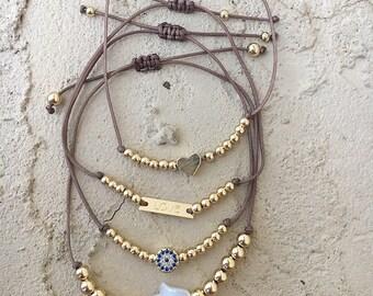 Adjustable string bracelets