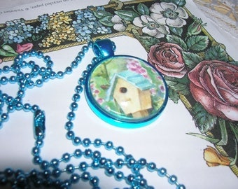 A birdhouse pendant ready for a birdie to move in