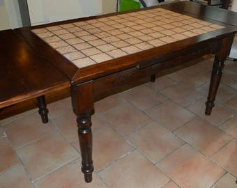 Solid wood table with travertine top