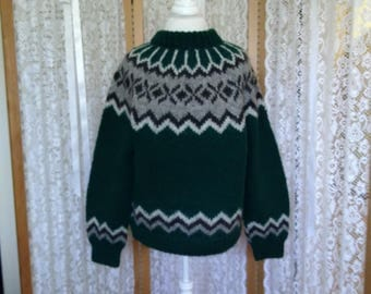 Very gently used. Icelandic wool fairisle in pine green and shades of gray. Size M.