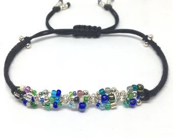 Macrame bracelet; silver wire, glass seed beads, cord, bracelet
