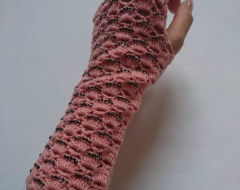 Hand crocheted light pink mittens with dark glass beads.