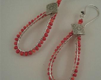 Wired earrings with deep orange beads