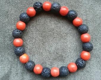 Orange and Black beaded stretch Bracelet (handcrafted)