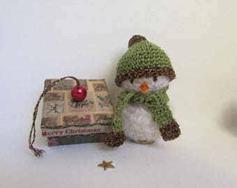 snowman with his gift hanging hook