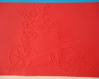 Red embossed card background cut wheelbarrow flower