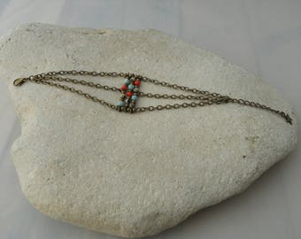 Bronze collection bracelet and 2 red and turquoise beads