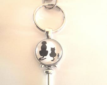 Keychain dog glass cabochon cat and mouse black silhouettes on white background