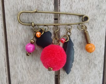 Brooch beads, tassel and charms recycled inner tube