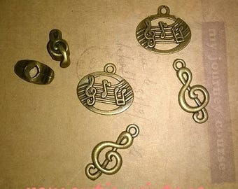 6 charms, charms, bronze 13-21mm approx.
