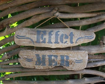 "Driftwood re-imagined in sign ""Effect sea"""