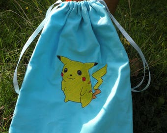 baby shoes, snacks or other pokemon, Pikachu backpack