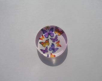 Cabochon 25 mm round and flat with the image of purple and orange butterflies