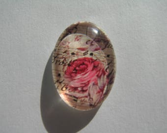 Glass cabochon oval 25 X 18 mm with rose on a background image musical