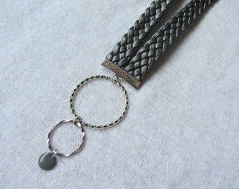 pendant necklace modern and urban iridescent grey faux leather braid, sequin gray enamel round charm and metal rings