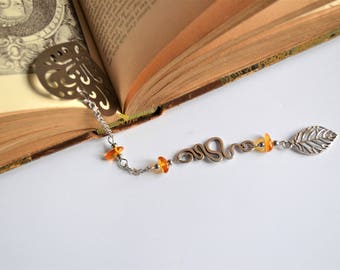 Bookmark made of stainless steel and silver plated decorated with amber chips / heart, scroll and leaf.